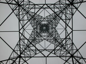 Huge powerline tower seen from center bottom for geometric effect.